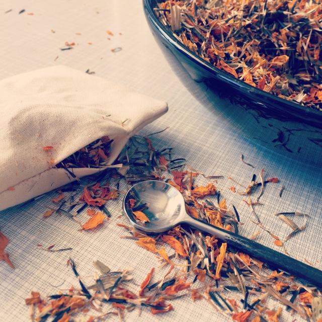 Marigold flower petal sachet in muslin pouch