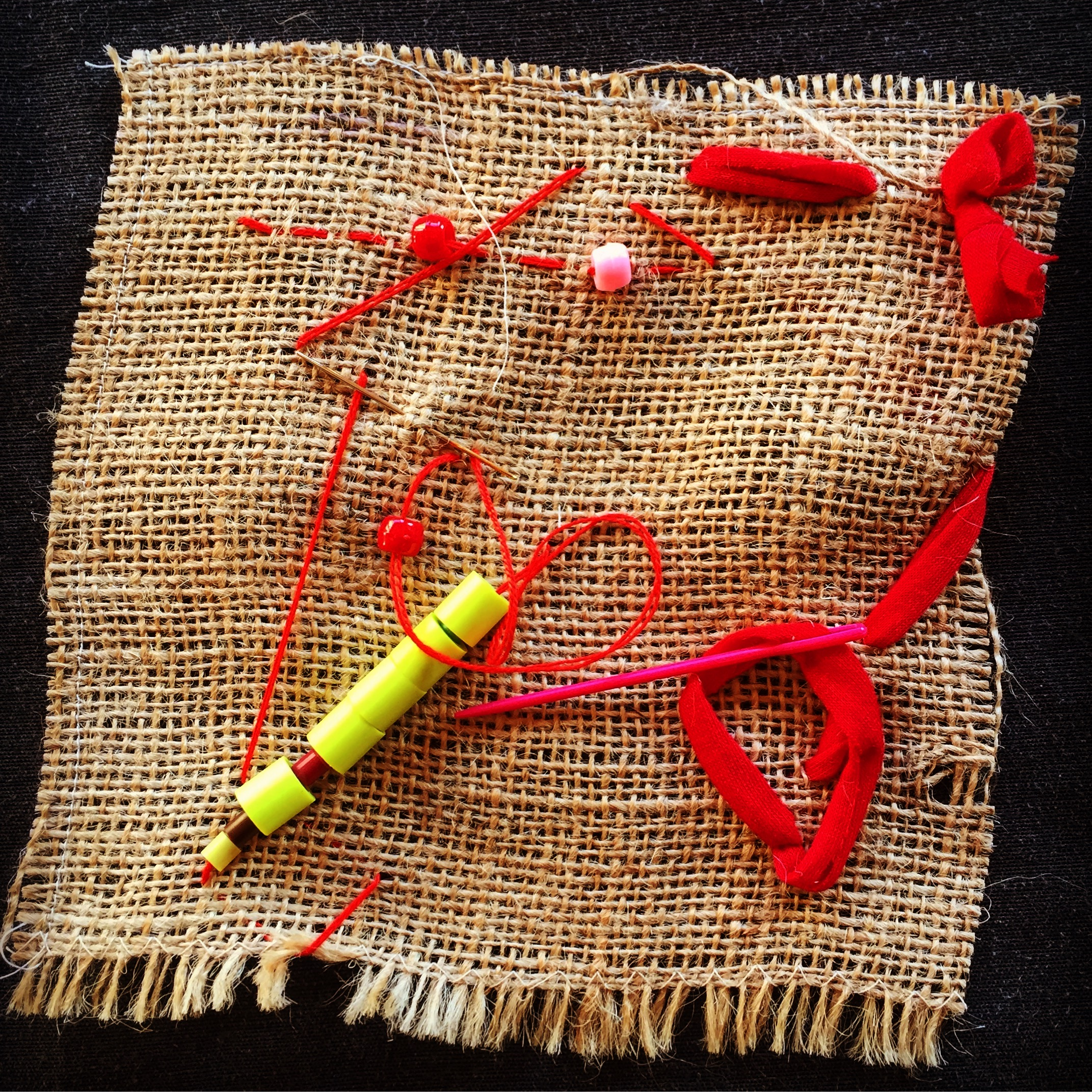 Kids weaving and sewing on burlap